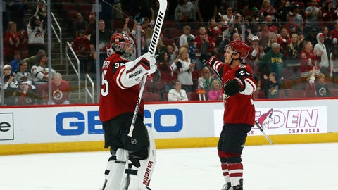 <p>               Arizona Coyotes goaltender Darcy Kuemper, left, celebrates a shutout win against the Minnesota Wild with Coyotes center Nick Cousins, right, as time expires in the third period of an NHL hockey game Sunday, March 31, 2019, in Glendale, Ariz. The Coyotes defeated the Wild 4-0. (AP Photo/Ross D. Franklin)             </p>