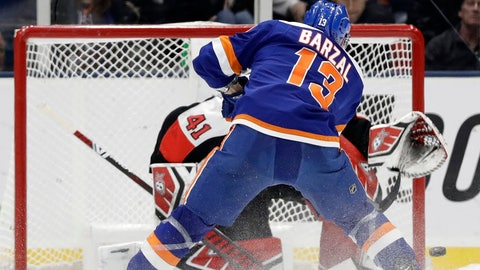 <p>               New York Islanders center Mathew Barzal (13) scores on Ottawa Senators goaltender Craig Anderson (41) in the shootout of an NHL hockey game, Tuesday, March 5, 2019, in Uniondale, N.Y. The Islanders won 5-4. (AP Photo/Kathy Willens)             </p>