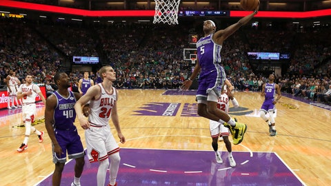 <p>               Sacramento Kings guard De'Aaron Fox, right, goes to the basket as Chicago Bulls forward Lauri Markkanen (24) watches during the first half of an NBA basketball game Sunday, March 17, 2019, in Sacramento, Calif. (AP Photo/Rich Pedroncelli)             </p>