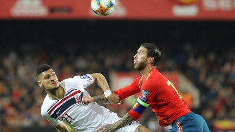 <p>               Spain's Sergio Ramos, right, challenges for the ball with Norway's Bjorn Johnsen during the Euro 2020 group F qualifying soccer match between Spain and Norway at the Mestalla stadium in Valencia, Spain, Saturday, March 23, 2019. (AP Photo/Alberto Saiz)             </p>