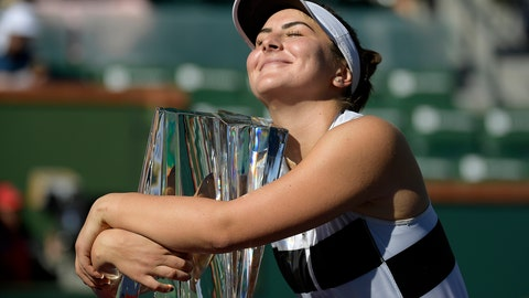 <p>               FILE - In this Sunday, March 17, 2019, file photo, Bianca Andreescu, of Canada, smiles as she hugs her trophy after defeating Angelique Kerber, of Germany, in the women's final at the BNP Paribas Open tennis tournament, in Indian Wells, Calif. Roger Federer has won one trophy so far in 2019, which puts him in a tie for the ATP lead, with 18 other players. That same sort of unprecedented parity is going on in the WTA, with 13 different champions from 13 tournaments. (AP Photo/Mark J. Terrill, File)             </p>