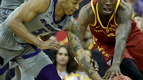 <p>               Kansas State's Barry Brown Jr. (5) and Iowa State's Cameron Lard (2) chase a loose ball during the second half of an NCAA college basketball game in the Big 12 men's tournament Friday, March 15, 2019, in Kansas City, Mo. Iowa State won 63-59. (AP Photo/Charlie Riedel)             </p>