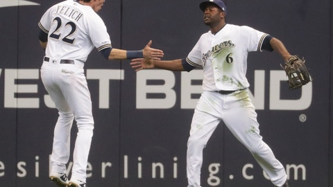 <p>               Milwaukee Brewers' Lorenzo Cain is congratulated by Christian Yelich after catching a ball at the wall hit by St. Louis Cardinals' Jose Martinez during the ninth inning of an Opening Day baseball game Thursday, March 28, 2019, in Milwaukee. The Brewers won 5-4. (AP Photo/Morry Gash)             </p>