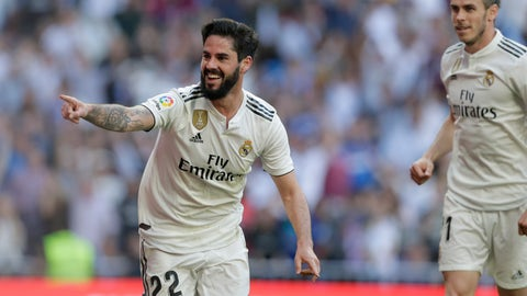 <p>               Real Madrid's Isco celebrates after scoring during a Spanish La Liga soccer match between Real Madrid and Celta at the Santiago Bernabeu stadium in Madrid, Spain, Saturday, March 16, 2019. At right his Real Madrid's Gareth Bale. (AP Photo/Paul White)             </p>
