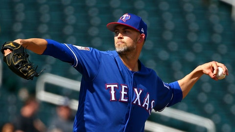 <p>               FILE - In this Feb. 25, 2019, file photo, Texas Rangers pitcher Mike Minor throws against the Cleveland Indians during the second inning of a spring training baseball game in Goodyear, Ariz. (AP Photo/Ross D. Franklin, File)             </p>