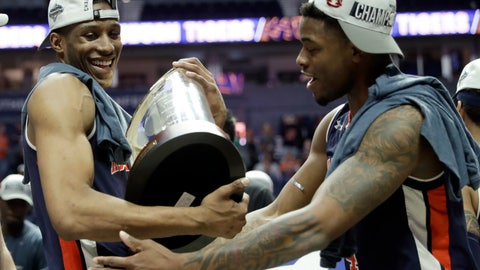 <p>               Auburn's Horace Spencer, left, holds the trophy as he celebrates with teammate Malik Dunbar after defeating Tennessee in the championship game of the NCAA Southeastern Conference basketball tournament Sunday, March 17, 2019, in Nashville, Tenn. Auburn won 84-64. (AP Photo/Mark Humphrey)             </p>