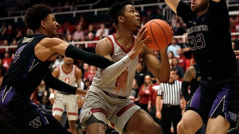 <p>               Stanford's KZ Okpala, center, looks to shoot between Washington's Sam Timmins (33) and Matisse Thybulle, left, in the first half of an NCAA college basketball game Sunday, March 3, 2019, in Stanford, Calif. (AP Photo/Ben Margot)             </p>