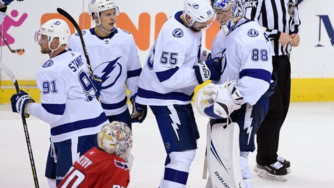 <p>               Tampa Bay Lightning goaltender Andrei Vasilevskiy (88), of Russia, celebrates with defenseman Braydon Coburn (55), center Yanni Gourde, second from left, and center Steven Stamkos (91) as Washington Capitals goaltender Braden Holtby (70) skates by after an NHL hockey game Wednesday, March 20, 2019, in Washington. The Lightning won 5-4 in overtime. (AP Photo/Nick Wass)             </p>