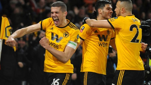 <p>               Wolverhampton's Raul Jimenez, centre, celebrates with teammates after scoring his side's opening goal during the English FA Cup Quarter Final soccer match between Wolverhampton Wanderers and Manchester United at the Molineux Stadium in Wolverhampton, England, Saturday, March 16, 2019. (AP Photo/Rui Vieira)             </p>