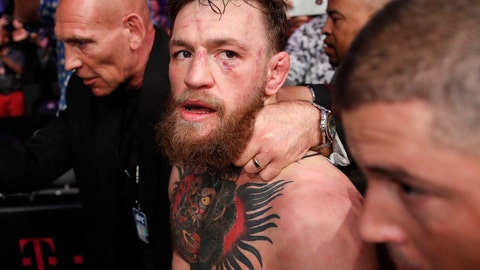 """<p>               FILE - In this Oct. 6, 2018, file photo, Conor McGregor walks out of the arena after he was defeated by Khabib Nurmagomedov in a lightweight title mixed martial arts bout at UFC 229 in Las Vegas. Superstar UFC fighter McGregor has announced on social media that he is retiring from mixed martial arts. McGregor's verified Twitter account had a post early Tuesday, March 26, 2019,  that said the former featherweight and lightweight UFC champion was making a """"quick announcement.""""(AP Photo/John Locher, File)             </p>"""