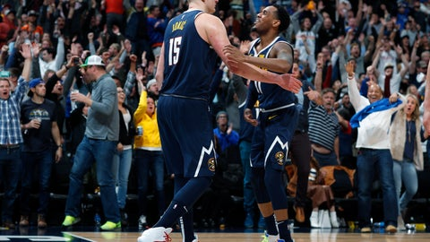 <p>               Denver Nuggets center Nikola Jokic, left, is congratulated for his game-winning basket by guard Monte Morris during the team's NBA basketball game against the Dallas Mavericks on Thursday, March 14, 2019, in Denver. The Nuggets won 100-99. (AP Photo/David Zalubowski)             </p>