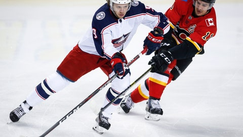 <p>               Columbus Blue Jackets' Artemi Panarin, left, keeps Calgary Flames' Mikael Backlund away from the puck during the first period of an NHL hockey game in Calgary, Alberta, Tuesday, March 19, 2019. (Jeff McIntosh/The Canadian Press via AP)             </p>