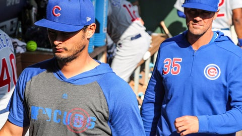 <p>               Chicago Cubs' pitchers Yu Darvish (11) and Cole Hamels (35), former Rangers' pitchers leave the dugout during the baseball game against the Texas Rangers Thursday, March 28, 2019 in Arlington, Texas. (AP Photo/Richard W. Rodriguez)             </p>