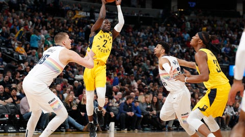 <p>               Indiana Pacers guard Darren Collison, second from left, looks to pass the ball to center Myles Turner, right, as Denver Nuggets center Nikola Jokic, left, and guard Jamal Murray defend during the first half of an NBA basketball game Saturday, March 16, 2019, in Denver. (AP Photo/David Zalubowski)             </p>