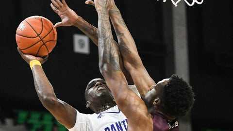 <p>               Prairie View A&M forward Devonte Patterson (5) shoots over Texas Southern center Trayvon Reed (5) during the first half of the SWAC championship NCAA college basketball game Saturday, March 16, 2019, in Birmingham, Ala. (AP Photo/Julie Bennett)             </p>