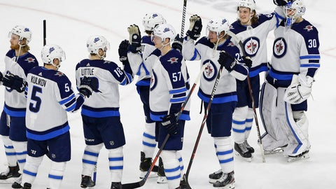 <p>               Winnipeg Jets goalie Laurent Brossoit (30) is congratulated by Sami Niku, of Finland, and other teammates following an NHL hockey game against the Carolina Hurricanes in Raleigh, N.C., Friday, March 8, 2019. (AP Photo/Gerry Broome)             </p>