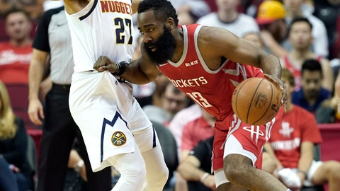 <p>               Houston Rockets' James Harden (13) tries to drive around Denver Nuggets' Jamal Murray (27) during the first half of an NBA basketball game Thursday, March 28, 2019, in Houston. (AP Photo/David J. Phillip)             </p>