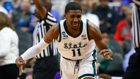 <p>               Michigan State forward Aaron Henry gestures after making a 3-pointer against LSU during the first half of an East Regional semifinal in the NCAA men's college basketball tournament in Washington, Friday, March 29, 2019. (AP Photo/Patrick Semansky)             </p>