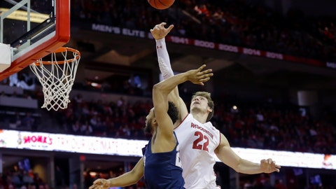 <p>               Wisconsin's Ethan Happ (22) blocks a shot by Penn State's Josh Reaves (23) during the first half of an NCAA college basketball game Saturday, March 2, 2019, in Madison, Wis. (AP Photo/Andy Manis)             </p>