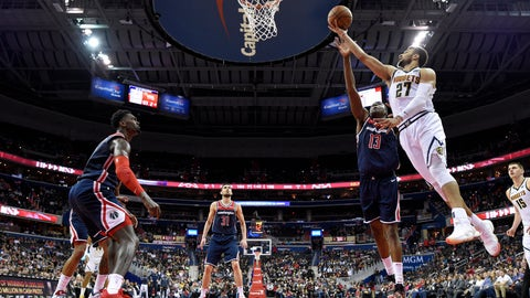 <p>               Denver Nuggets guard Jamal Murray (27) goes to the basket against Washington Wizards center Thomas Bryant (13), guard Tomas Satoransky (31) and forward Bobby Portis, left, during the second half of an NBA basketball game Thursday, March 21, 2019, in Washington. The Nuggets won 113-108. (AP Photo/Nick Wass)             </p>