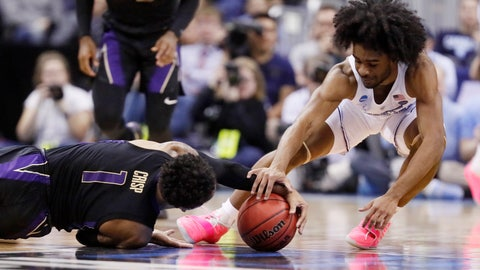 <p>               Washington's David Crisp (1) and North Carolina's Coby White (2) battle for a loose ball in the first half during a second round men's college basketball game in the NCAA Tournament in Columbus, Ohio, Sunday, March 24, 2019. (AP Photo/John Minchillo)             </p>