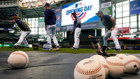 <p>               Milwaukee Brewers players warm up before an Opening Day baseball game against the St. Louis Cardinals Thursday, March 28, 2019, in Milwaukee. (AP Photo/Morry Gash)             </p>