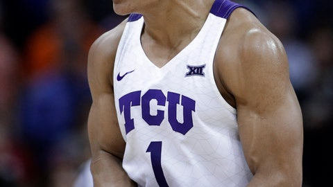 <p>               TCU's Desmond Bane celebrates after making a 3-point shot during the second half of the team's NCAA college basketball game against Oklahoma State in the Big 12 men's tournament Wednesday, March 13, 2019, in Kansas City, Mo. against TCU won 73-70. (AP Photo/Charlie Riedel)             </p>