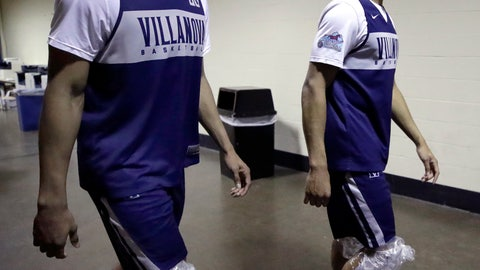 <p>               Villanova's Jermaine Samuels, left, and Phil Booth walk with ice packs on their knees after a news conference at the men's college basketball NCAA Tournament, Friday, March 22, 2019, in Hartford, Conn. Villanova faces Purdue on Saturday in the second round. (AP Photo/Elise Amendola)             </p>