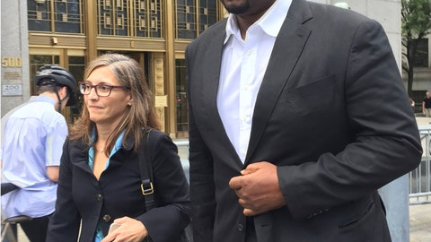 <p>               FILE -- In this Oct. 10, 2017 file photo, former Auburn University assistant men's basketball coach, Chuck Person, leaves Manhattan federal court in New York, after an initial appearance before a magistrate judge. Person is scheduled to plead guilty on Tuesday, March 19, 2019 to a conspiracy charge in a scandal that involved bribes paid to families of NBA-bound young athletes to steer them to top schools and favored money managers and agents. (AP Photo/Larry Neumeister, File)             </p>