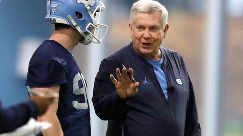 <p>               FILE - In this March 3, 2019, file photo, North Carolina head coach Mack Brown talks with Cooper Graham (96) during UNC's first spring football practice, in Chapel Hill, N.C. Brown is back for his second stint as coach of the Tar Heels and is pushing his players for more focus, execution and urgency in spring drills. (Ethan Hyman/The News & Observer via AP, File)/=             </p>