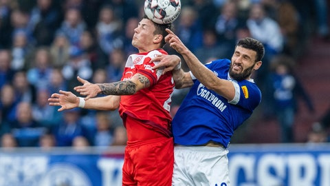 <p>               Duesseldorf's Dawid Kownacki, left, and Schalke's Daniel Caligiuri, right, challenge for the ball during the German Bundesliga soccer match between FC Schalke 04 and Fortuna Duesseldorf in Gelsenkirchen, Germany, Saturday, March 2, 2019. (Guido Kirchner/dpa via AP)             </p>
