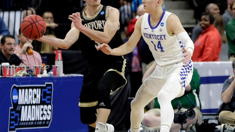 <p>               Wofford's Fletcher Magee, left, passes the ball around Kentucky's Tyler Herro (14) during the first half of a second-round game in the NCAA men's college basketball tournament in Jacksonville, Fla., Saturday, March 23, 2019. (AP Photo/John Raoux)             </p>