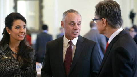 <p>               Major League Baseball Commissioner Rob Manfred, center, speaks with Boston Red Sox owner John Henry, right, and Boston Globe Managing Director Linda Henry, left, at a gathering of the Boston College Chief Executives Club, Wednesday, March 6, 2019, in Boston. (AP Photo/Steven Senne)             </p>