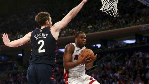 <p>               New York Knicks forward Luke Kornet (2) defends against Miami Heat guard Dion Waiters (11) during the first half of an NBA basketball game Saturday, March 30, 2019, in New York. (AP Photo/Nicole Sweet)             </p>