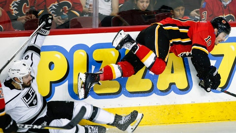 <p>               Los Angeles Kings' Drew Doughty, left, sends Calgary Flames' Derek Ryan flying during second-period NHL hockey game action in Calgary, Alberta, Monday, March 25, 2019. (Jeff McIntosh/The Canadian Press via AP)             </p>