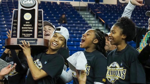 <p>               Towson forward Nukiya Mayo (1) holds the trophy as they celebrate their 53-49 win over Drexel in an NCAA college basketball game in the championship of the Colonial Athletic Association tournament, Saturday, March 16, 2019, in Newark, Del. (AP Photo/Suchat Pederson)             </p>