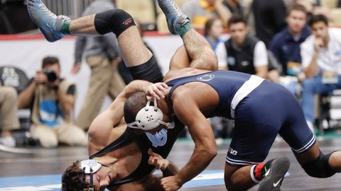 <p>               Penn State'a Mark Hall, right, lifts North Carolina's Devin Kane in their 174 lbs. match in the first round of the NCAA college wrestling championship, Thursday, March 21, 2019, in Pittsburgh. (AP Photo/Keith Srakocic)             </p>