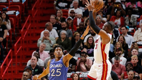 <p>               Miami Heat guard Dwyane Wade (3) shoots over Orlando Magic forward Wesley Iwundu (25) in the first quarter during an NBA basketball game Tuesday, March 26, 2019, in Miami.(AP Photo/Joe Skipper)             </p>