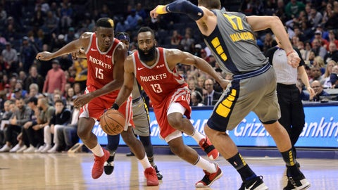<p>               Houston Rockets guard James Harden (13) drives between teammate Clint Capela (15) and Memphis Grizzlies center Jonas Valanciunas (17) during the second half of an NBA basketball game Wednesday, March 20, 2019, in Memphis, Tenn. The Grizzlies won 126-125 in overtime. (AP Photo/Brandon Dill)             </p>