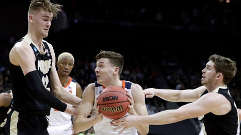 <p>               Virginia's Kyle Guy, middle, goes to the basket against Purdue's Ryan Cline, right, and Matt Haarms (32) during the first half of the men's NCAA Tournament college basketball South Regional final game, Saturday, March 30, 2019, in Louisville, Ky. (AP Photo/Michael Conroy)             </p>