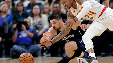 <p>               Orlando Magic's Nikola Vucevic, left, and Atlanta Hawks' Kent Bazemore (24) go after a loose ball during the first half of an NBA basketball game, Sunday, March 17, 2019, in Orlando, Fla. (AP Photo/John Raoux)             </p>