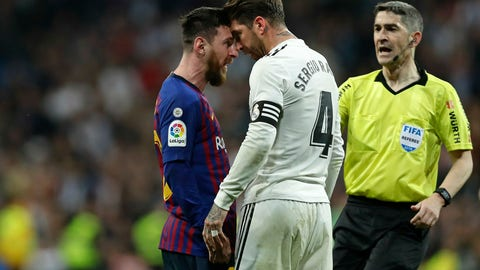 <p>               Barcelona forward Lionel Messi, left, goes head to head with Real defender Sergio Ramos after they argue during the Spanish La Liga soccer match between Real Madrid and FC Barcelona at the Bernabeu stadium in Madrid, Saturday, March 2, 2019. (AP Photo/Manu Fernandez)             </p>
