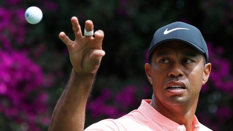 """<p>               FILE - In this Feb. 22, 2019, file photo, Tiger Woods prepares to catch a ball tossed by his caddied on the second day of competition of the WGC-Mexico Championship golf tournament at the Chapultepec Golf Club in Mexico City. Woods says a sore neck that kept him out of Bay Hill last week is no longer painful. Woods says his job is to make sure to stay fit and flexible. He used the word """"pliable"""" three times during his news conference at The Players Championship.  (AP Photo/Marco Ugarte, File)             </p>"""