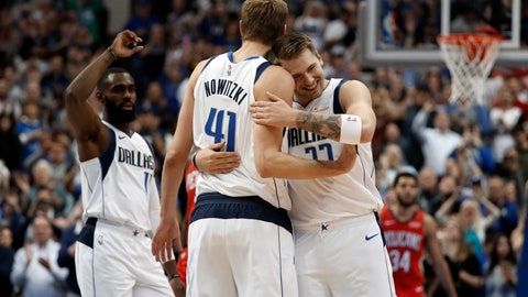 <p>               Dallas Mavericks' Tim Hardaway Jr., left, and Luka Doncic (77) celebrate with Dirk Nowitzki (41) after Nowitzki scored a basket in the first half of an NBA basketball game against the New Orleans Pelicans in Dallas, Monday, March 18, 2019. The basket placed Nowitzki as the sixth all-time league leading scorer surpassing Wilt Chamberlain. (AP Photo/Tony Gutierrez)             </p>
