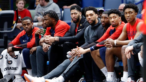 <p>               New Orleans Pelicans forward Anthony Davis, center, watches from the bench in street clothes in the first half of an NBA basketball game against the Atlanta Hawks in New Orleans, Tuesday, March 26, 2019. (AP Photo/Gerald Herbert)             </p>