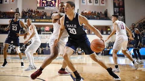 <p>               Yale's Paul Atkinson, front, dribbles as Harvard's Chris Lewis, back, defends during the first half of an NCAA college basketball game for the Ivy League championship at Yale University in New Haven, Conn., Sunday, March 17, 2019, in New Haven, Conn. (AP Photo/Jessica Hill)             </p>