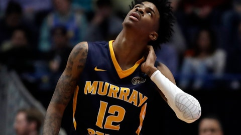<p>               Murray State's Ja Morant (12) looks up at the scoreboard during the first half of a second round men's college basketball game against Florida State in the NCAA Tournament, Saturday, March 23, 2019, in Hartford, Conn. (AP Photo/Elise Amendola)             </p>