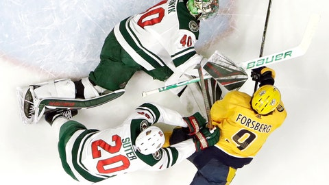 <p>               Minnesota Wild goaltender Devan Dubnyk (40) reaches for the puck with Nashville Predators left wing Filip Forsberg (9), of Sweden, in the first period of an NHL hockey game Tuesday, March 5, 2019, in Nashville, Tenn. Also defending for the Wild is Ryan Suter (20). (AP Photo/Mark Humphrey)             </p>
