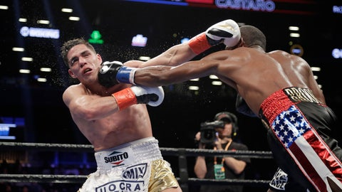 <p>               Cuba's Erislandy Lara, right, punches Argentina's Brian Carlos Castano during the ninth round of a WBA super welterweight championship boxing match Saturday, March 2, 2019, in New York. (AP Photo/Frank Franklin II)             </p>