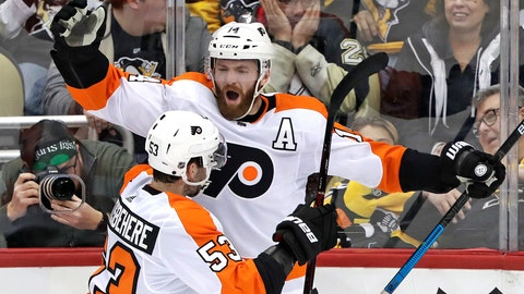 <p>               Philadelphia Flyers' Sean Couturier (14) celebrates with Shayne Gostisbehere (53) after getting the game-winning goal past Pittsburgh Penguins goaltender Matt Murray in the overtime of an NHL hockey game in Pittsburgh, Sunday, March 17, 2019. The Flyers won 2-1. (AP Photo/Gene J. Puskar)             </p>